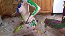 Lavender Rayne and Indigo Augustine playing with paint