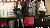 Redheaded milf Amber Dawn looks so slutty in bl...