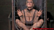 Caged sub sucking her doms cock