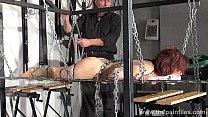 Redhead amateur slavegirl Bembys metal bondage lowered over burning candles and