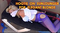 HOGTIE ON SUNLOUNGER FOR ELEGANT BLONDE.