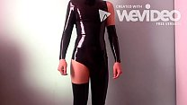 teen boy in latex catsuit inserts buttplug