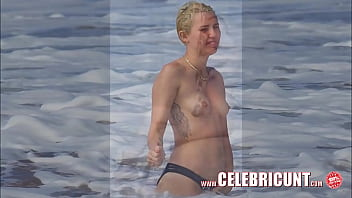 Miley cyrus flaunting her hot nude ..