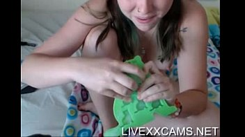 Teen hottie inserts ice cube in her pussy, anal toy in ass