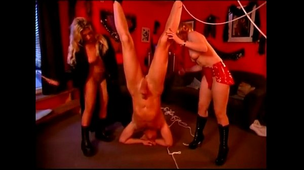 Two mistresses whipping a tied up guy