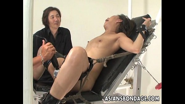 image Bound asian handles sex machines like a trooper