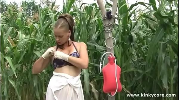 Kinkycore milk enema in the garden 5