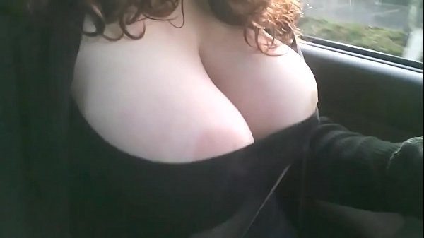 Boobs pop out in car