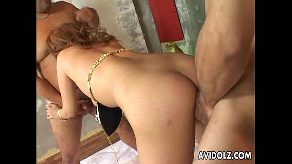 Sexy Asian with two cocks in her mouth