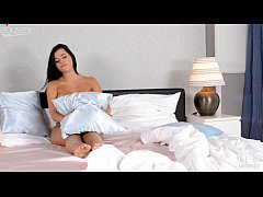 AnySex Sensual tanned brunette strokes her fake...