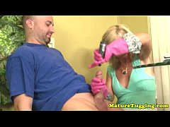 Blonde mom tugs cock with rubber gloves
