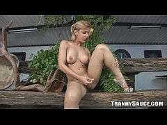 Busty blonde shemale hottie tugs her cock outdoors