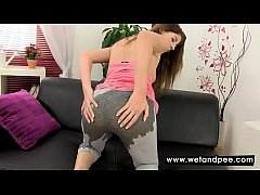Brunette pees on her pants to get wet