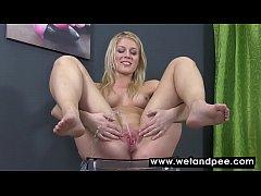 Sensual blonde showering herself in urine