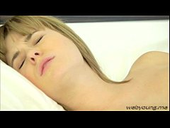 Pretty Charlize caresses her shaved pussy in th...