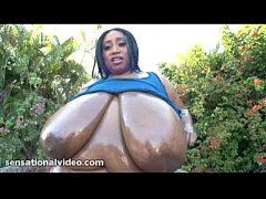 Huge Busty Black BBW OIls Up Her 46M Sized Tits