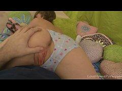 Teasing her boyfriend with her petite body