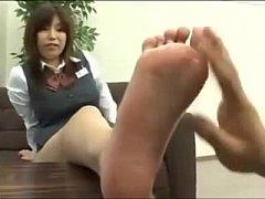 Japanese school girl shows her pretty feet