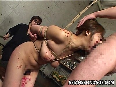 Asian slut has a cock to suck as she's tied up (8 min)